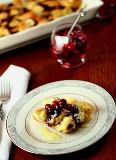 Cranberry and Croissant Bread Pudding with Champagne Zabaglione	  Prep time: 15 mins   Cook time: 50 mins   Serves: 6 to 8  A rich and beautiful dessert using your favorite dried berries.