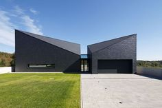 sharp slanted roofs covered in dark slate rocks make the structure a focal point among the surrounding buildings.