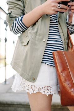 Forget the tiny slip-skirt, I want a pair of jeans and boots, but love the top-half of this outfit!