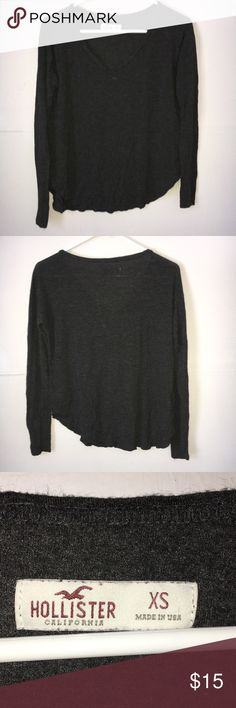 Hollister V Neck Split Side Long Sleeve Shirt EUC.The bottom of the sides are split style.The back is slightly longer than the front.The color is a charcoal gray. Hollister Tops Tees - Long Sleeve