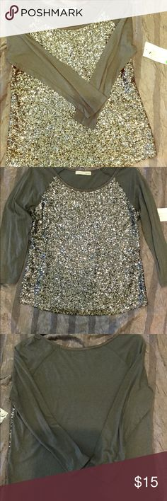 Gray Raglan Sleeve Top with Sequined Front Kersh Gray Raglan Sleeve Top with Silver Sequined Front.  Cotton Modal blend with 100% Polyester. Kersh Tops Tees - Long Sleeve