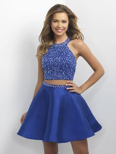 Step onto the dance floor in this adorable two-piece party dress featuring a sequined high-neck halter top with an open back, paired with a flared skirt with a matching beaded belt, and it's at Rsvp P