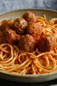 NYT Cooking: Carbohydrate avoidance be damned: pasta with meatballs is the perfect culinary counter to the cruel world. Just looking at a slippery, tomato-sauced tangle of spaghetti topped with juicy toothsome meatballs makes you feel better; eating it is the instant antidote to whatever ails you. The recipe here makes more sauce, perhaps, than you'd normally want to use to dress a pound of pasta, but when ...