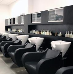 Love the modern ergonomic shape of the salon chairs, Salon of Distinction: Modern Salon & Spa—Phillips Place | Salon Today