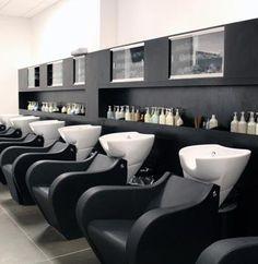 Love the modern ergonomic shape of the salon chairs, Salon of Distinction: Modern Salon & Spa—Phillips Place   Salon Today