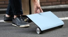 You Can Soon Buy That Tiny Scooter That Looks Like a Laptop You Can Ride