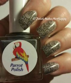 "Parrot Polish!!  ""Black Magic"". How about a built in ‪#‎gradient‬ with a great ‪black to gray #‎thermal‬ polish! This is just unbelievably beautiful!!! Gray is warm, it darkens to black as it gets cooler!  I'm so in love with this, as I do love a gray/black ‪#‎manicure‬ ‪#‎notd‬   You just can't go wrong with this one!!! I did add a pretty ‪#‎stamp‬ to this too, using KD27."