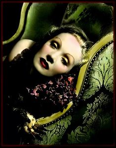 Marlene Dietrich and green.        What can I say. Beautiful woman, beautiful Color pallet. Just a beautiful photo.