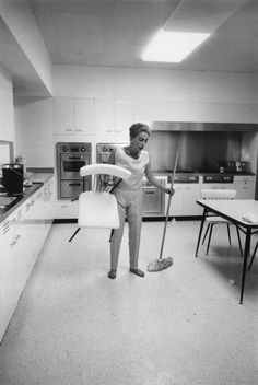 """Joan Crawford,  cleaning her kitchen, 1959.  """"I'm not mad at you, I'm mad at the dirt!"""""""