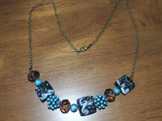 Turquoise blue and antique gold Necklace.  Has by GabiLuBoutique, $30.00