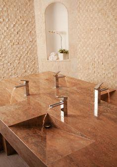 interesting built-in sink design for multiple washbasins.