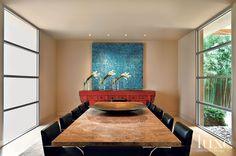 This Dallas dining room was designed around a massive granite table.