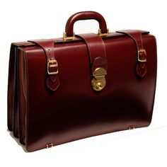 The Boston briefcase is designed for men.  It has 3 separate compartments, magnetic closure side straps and a middle lock with a key.  Designed as a hand carry bag.  In leather as shown