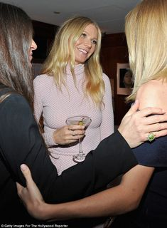 Cheers!: Gwyneth looked like she was having a great time, and sipped on a martini...