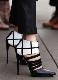 Shoes are a weakness for many of us and the constraints of a working wardrobe shouldn't limit our lust for fancy footwear. These monochromatic, graphic beauties harken to cubist art but their simple structure makes them the perfect partner to a black and white outfit.