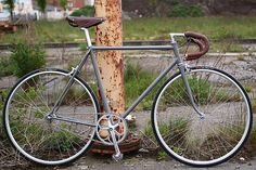 Grey Singlespeed by mrjohan, via Flickr Italian frame from the 70s, Barale. Brooks B-17 Narrow in brown and matching Brooks leather tape for the drops.