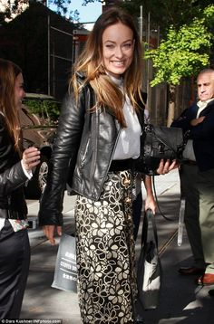 Coordinating: Olivia coupled her black and white floral skirt with a long-sleeved, texture...