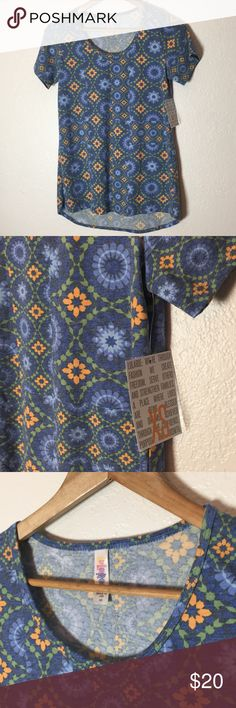 🆕NWT Lularoe Classic T This tee is a weathered floral pattern. It's the classic t style. There is a tiny small hole by the left armpit. Not incredibly noticeable but priced with this in mind. NWT, size XS. Save on ✈️SHIPPING✈️and 🎁BUNDLE! I even give a discount on 3 or more regularly priced item bundles. I always accept reasonable offers with the offer button! 🚫❌Lowball offers please! LuLaRoe Tops