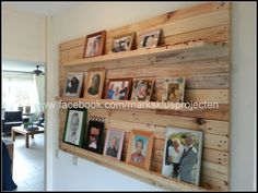 Photo wall made of recycled pallet wood #PalletPhotoFrame, #PalletShelves, #PalletWall