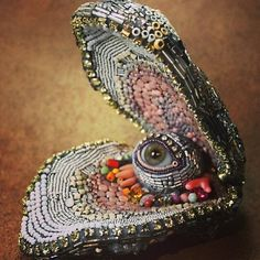 """""""Oyster Eye Beaded sculpture by Betsy Youngquist, Victorian Mourning Brooch. Textiles, Arte Popular, Sculpture, Weird And Wonderful, Schmuck Design, Mosaic Art, Bead Art, Beaded Embroidery, Leather Embroidery"""