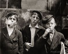 Newsies at Skeeter's Branch, Jefferson near Franklin. They were all smoking. Location: St. Louis, Missouri. 11:00 A. M . Monday, May 9th, 1910. Photographed by Lewis Hine on 4x5 glass plate negative.