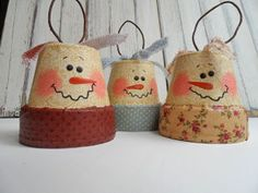 Clay Pot Snowmen | FaveCrafts.com  Easy and pretty cheap. You don't have to follow these direction exactly, have fun with it