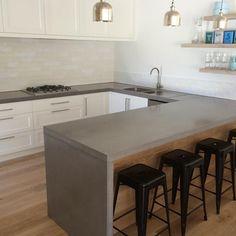 Island bench top featuring Caesarstone Sleek Concrete. | Kitchens ...
