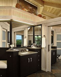A rustic bathroom with modern vanity. #InteriorDesignDetails