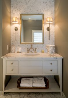 Pretty guest bathroom---especially vanity, tile, faucet, and lights!!