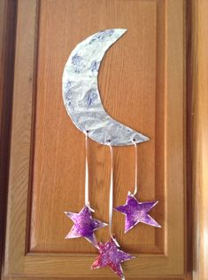 Moon and the Stars Craft - the moon is covered in foil and decorated with glitter glue, stars are card stock with glitter - Preschool Craft - Space Craft - Kids Craft