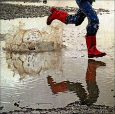 Love this photo of someone running through puddles on a rainy day!  #Indiana #RainyDay
