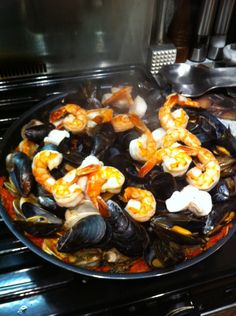Shrimp, mussels, clams, monk fish, garlic and tomatoes.