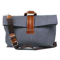 Navy herringbone makes this an inspired and stylish handbag that you can dress up or down.
