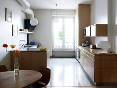 Vaguely similar massing with the fridge at the wall. Modern style could work with industrial touches.