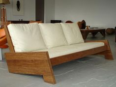 """Asturias Sofa by Carlos Motta """"Asturias"""" sofa is a bold option with a sophisticated, rustic look. Motta designed this line of furniture using reclaimed and demolition wood, plentiful in urban centers like São Paulo."""