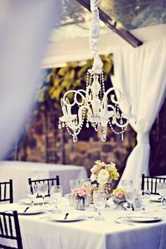 A white and glass Haiku Mill chandelier above the tables to light up your reception.