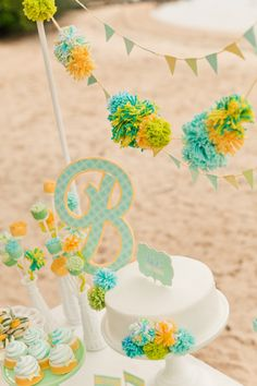 Gender neutral baby shower with gorgeous cake stands, favors and pom pom hanging decor. Mint, lime, yellow and pastel green set the tone for this beach side gorgeous baby shower. Baby Shower Themes Neutral, Baby Shower Yellow, Baby Yellow, Baby Boy Shower, Beach Baby Showers, Elephant Baby Showers, Baby Shower Favors, Baby Shower Parties, Baby Shower Table Decorations
