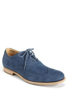 """Wing tips will rule spring and summer, redefining what """"fly"""" is all about. These are Rockports, $225. Get after 'em."""