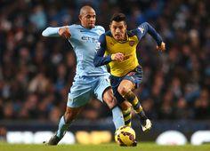 Jan.18th. 2015: Santi Cazorla beats Manchester City's Fernadinho to the ball in Arsenal 2-0 away win.
