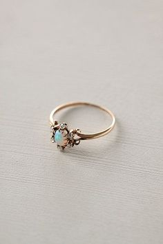 Opal & Diamond Flower Ring #anthropologie I would want to wear this every…