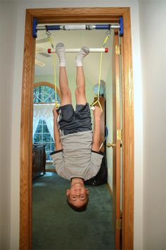 Trapeze bar for developing upper body strength for kids. Hanging and swinging are important movements for children. Great way to bring the outdoors inside when cold weather arrives and it's hard to play on the monkey bars.
