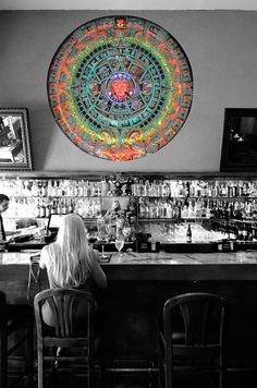 I grabbed this photo in down town West Palm Beach Florida. I love the stained glass over the bar and saw just one person setting at the bar early in the day. I couldn't resist.