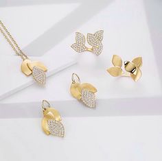 A re-imagination of the ethereal symbol, the Lotus collection conjures the divine and daring with cascading leaf designs, commanding attention with every move she makes. Gold Pendent, Pendant Set, Diamond Pendant, Lotus Jewelry, Diamond Jewelry, Diamond Earrings, Silver Jewellery, Chains, Jewelry Collection