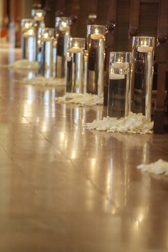 floating candles in glasses and petals, aisle and ceremony decor idea
