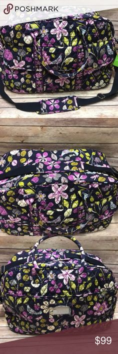 "VERA BRADLEY GRAND TRAVELER  FLORAL NIGHTINGALE VERA BRADLEY ""GRAND TRAVELER""  NEW WITH TAGS  RETIRED ""FLORAL NIGHTINGALE""   Vera Bradley's durable and spacious Grand Traveler Tote is made of soft quilted fabric. The fully zippered top closure secures an interior with 4 large open slip pockets. The Grand Traveler is offered in two styles.The front has a flap covering two large slip pockets. The back side features two open slip pockets and an open trolley sleeve to slide the Grand Traveler…"