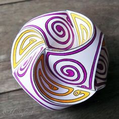 Color and craft these stunning globes out of three stripes of paper with Hattifant's printables and video tutorial.
