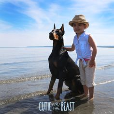 Dressed for the beach with her Doberman best friend.