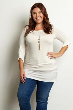 b3833bc29d7 This is the perfect plus size tunic dress to style with all your favorite  pieces