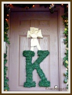 Pick up a large paper mache letter at your craft store, wrap with thin wired garland.