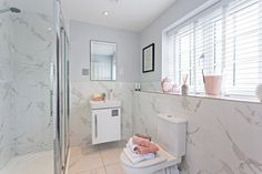 This is one of our bathrooms at Clockmaker's Tower. It has a light fresh feel to it thanks to the marble effect tiles and blush accessories. Kings Home, Marble Effect, New Homes For Sale, New Builds, Double Vanity, Luxury Homes, Bathrooms, Tiles, Bathtub